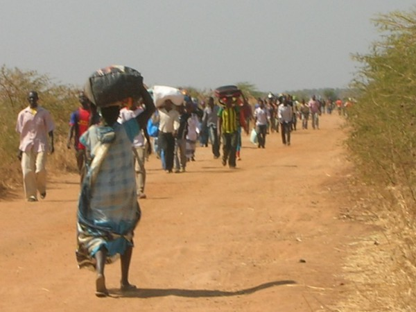 Civilians running to the UN base in Malakal, 2014