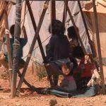 crianças em campo de refugiados