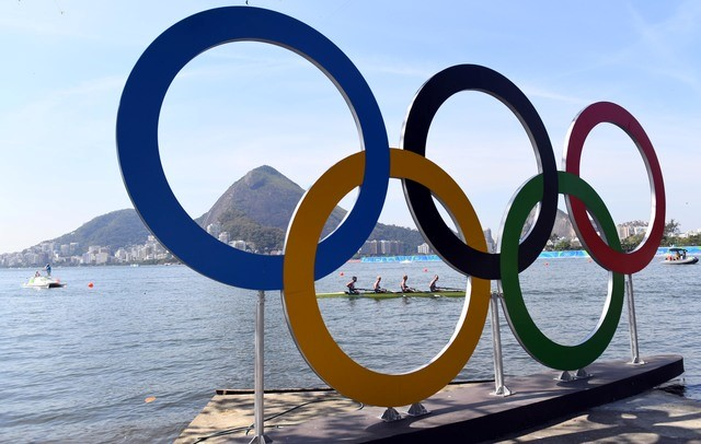Rowers are seen through the Olympic rings as seen from Copacabana Beach. Mandatory Credit: Jack Gruber-USA TODAY Sports
