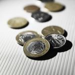 Crise econômica, o que é e como afeta meu bolso?